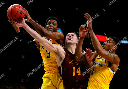 Loyola-Chicago guard Ben Richardson (14) fights for a rebound with Michigan guard Zavier Simpson, left, and Charles Matthews, right, during the second half in the semifinals of the Final Four NCAA college basketball tournament, in San Antonio. Michigan won 69-57