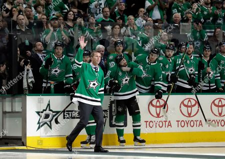Stock Photo of Former Dallas Stars player Mike Modano acknowledges cheers from fans during a pregame ceremony where Modano was honored before a NHL hockey game against the Minnesota Wild in Dallas