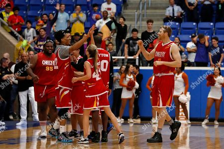 Michael Purdie, Allie LaForce, Matt Bonner. Team Cheez-It players celebrate during the Celebrity Crunch Classic presented by Cheez-It and Pringles at the Northside Sports Gym, in San Antonio