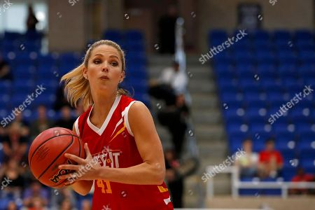 Allie LaForce, of Team Cheez-It, looks to pass the ball to an open teammate during the Celebrity Crunch Classic presented by Cheez-It and Pringles at the Northside Sports Gym, in San Antonio