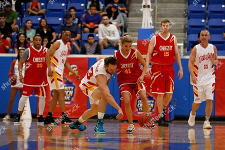 Joel McHale, Allie LaForce. Joel McHale, of Team Pringles, third from the left, steals the ball away from Allie LaForce, of Team Cheez-It, third from the right, during the Celebrity Crunch Classic presented by Cheez-It and Pringles at the Northside Sports Gym, in San Antonio
