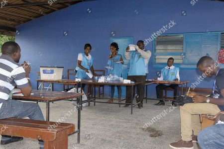 Stock Image of Electoral officials count votes at a polling station during the presidential election run-off in Freetown, Sierra Leone, 31 March 2018. Sierra Leone?s ruling party candidate Samura Kamara and opposition leader Julius Maada Bio are the two contenders in the election. The West African nation held a run-off election to replace President Ernest Bai Koroma after neither of the candidates secured enough votes for an outright victory during the first round.