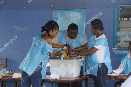 Stock Photo of Electoral officials seal a ballot box at a polling station during the presidential election run-off in Freetown, Sierra Leone, 31 March 2018. Sierra Leone?s ruling party candidate Samura Kamara and opposition leader Julius Maada Bio are the two contenders in the election. The West African nation held a run-off election to replace President Ernest Bai Koroma after neither of the candidates secured enough votes for an outright victory during the first round.