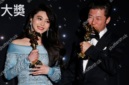 Tadanobu Asano, Fan Bingbing. Japanese actor Tadanobu Asano, right, and Chinese actress Fan Bingbing pose after winning the Best Actor and Actress Awards of the Asian Film Awards in Hong Kong