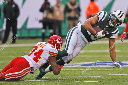 Darrelle Revis, Jermaine Kearse. Kansas City Chiefs' Darrelle Revis, left, tackles New York Jets' Jermaine Kearse during the first half of an NFL football game, in East Rutherford, N.J