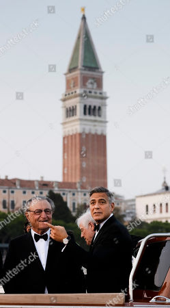 Stock Picture of George Clooney, Ramzi Alamuddin, Nick Clooney. Actor George Clooney, right, cruise in a boat with his father Nick Clooney, center, and Ramzi Alamuddin, father of her fiancee Amal Alamuddin, on their way to the Aman hotel ahead of his wedding in Venice, Italy, . In the background St. Mark's bell tower