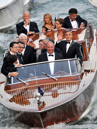 George Clooney, Ramzi Alamuddin, Nick Clooney, Nina Bruce. Actor George Clooney, right, waves from a boat with Ramzi Alamuddin, third from right front row, father of her fiancee Amal Alamuddin, his father Nick Clooney, fifth from right front row, and his mother Nina Bruce, second from right back row on their way to the Aman hotel ahead of his wedding in Venice, Italy
