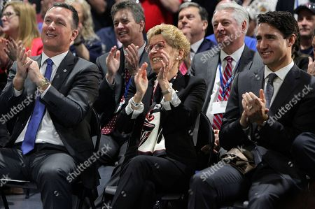 Mark Buzzell, Kathleen Wynne, Justin Trudeau. Canada's Prime Minister Justin Trudeau, right, Ontario Premier Kathleen Wynne, center, and Ford Motor Company of Canada CEO Mark Buzzell applaud during an announcement at the Ford Essex Engine Plant in Windsor, Ontario, Canada, on . Ford Motor Co. is hiring more than 300 engineers for a new connected-vehicle research center in Ottawa, Ontario, the automaker said Thursday