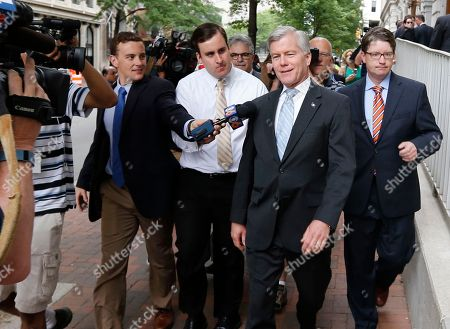 Former Virginia Gov. Bob McDonnell, second from right, answers questions as he arrives at the 4th Circuit Court of Appeals for a hearing on the appeal of his corruption conviction, in Richmond, Va