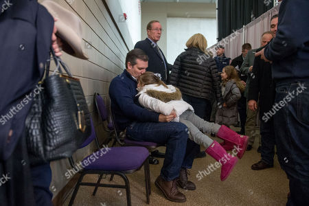 Ted Cruz, Catherine Cruz. Republican presidential candidate Sen. Ted Cruz, R-Texas, kisses his daughter Catherine, 4, as she plays on his lap as he waits off stage before being announced by radio and television personality Glenn Beck at a rally at the Five Sullivan Brothers Convention Center in Waterloo, Iowa