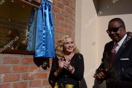 Pop star Madonna, left, and Malawian President Peter Mutharika, unveil a plaque at the opening of The Mercy James Institute for Pediatric Surgery and Intensive Care, at the Queen Elizabeth Central Hospital in the city of Blantyre, Malawi, . The children's wing facility is named after Madonna's adopted child 11-year-old Mercy James and building funded by her charity Raising Malawi in collaboration with Malawi's health ministry