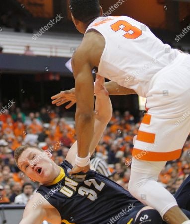 Andrew White III, Jordy Kuiper. UNC Greensboro's Jordy Kuiper, left, is fouled by Syracuse's Andrew White III during the second half of an NCAA college basketball game in the NIT in Syracuse, N.Y., . Syracuse won 90-77