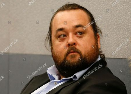 "Austin Lee Russell, better known as Chumlee from the TV series ""Pawn Stars,"" appears in court, in Las Vegas. Russell and his lawyers told a Las Vegas judge he intends to plead guilty in state court to felony weapon and misdemeanor attempted drug possession charges"