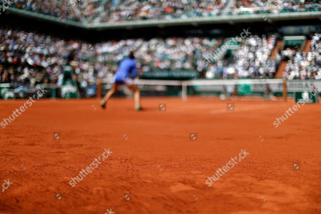 Stock Picture of Prints of the player's shoes are seen on the clay as France's Caroline Garcia, rear, plays against Karolina Pliskova of the Czech Republic during their quarterfinal match of the French Open tennis tournament at the Roland Garros stadium, in Paris, France