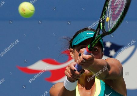 Madison Keys, of the United States, returns a shot to Tereza Smitkova, of the Czech Republic, during the second round of the U.S. Open tennis tournament, in New York