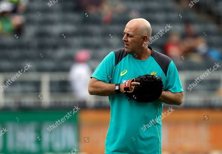 Australia's coach Darren Lehmann throws the ball during day three of the fourth cricket test match between South Africa and Australia at the Wanderers stadium in Johannesburg, South Africa