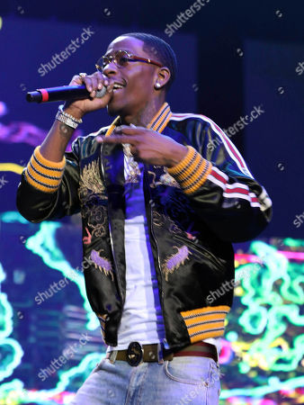 Rich Homie Quan, Dequantes Devontay Lamar. Rich Homie Quan performs during the V-103 Live Pop Up Concert at Philips Arena, in Atlanta