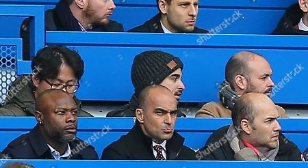 Stock Image of (CAPTION CORRECTION) Roberto Martinez and William Gallas watching todays match