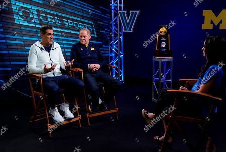 """Villanova head coach Jay Wright, left, and Michigan head coach John Beilein talk to Tracy Wolfson during an interview for CBS Sports Network's """"We Need to Talk"""" show before the championship game of the Final Four NCAA college basketball tournament, in San Antonio"""