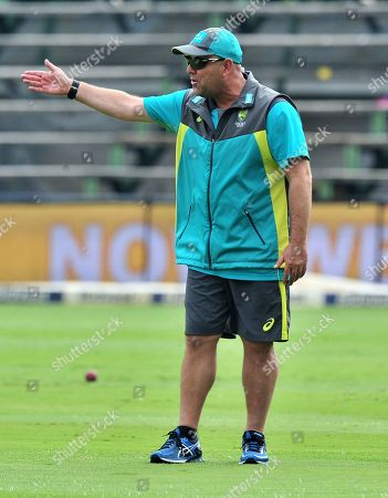 Stock Photo of Darren Lehmann, coach of Australia instructs players prior to the start of the Fourth Test match between South Africa and Australia at the New Wanderers Stadium in Johannesburg, South Africa, 30 March 2018.