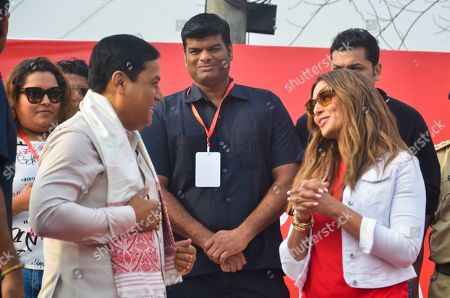 Stock Picture of Chief minister of Assam Sarbananda Sonowal met Bollywood Actress Bipasha Basu