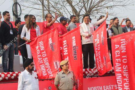 Bolllywood Actress Bipasha Basu and Chief minister of Assam Sarbananda Sonowal flagged off first International half Marathon for Clean India.