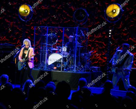 The Pretenders, Chrissie Hynde, Martin Chambers, James Welbourne. The English/American rock band The Pretenders, with frontwoman Chrissie Hynde, drummer Martin Chambers, center, and lead guitarist James Welbourne performs at the Orpheum Theater in Boston