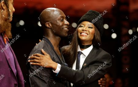 Naomi Campbell, Oswald Boateng. Fashion Designer Oswald Boateng and British model Naomi Campbell, right, hug each other on the runway during the ARISE Fashion Week event in Lagos, Nigeria