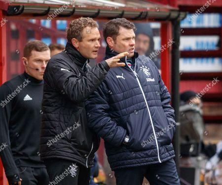Stock Photo of Rangers Coach Jonatan Johansson speaks to Rangers Manager Graeme Murty