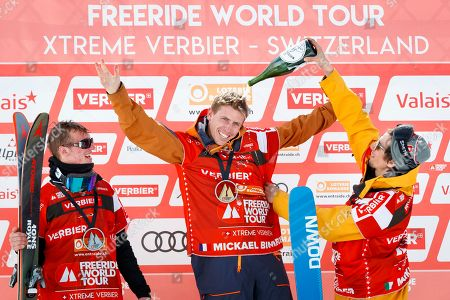 """Mickael Bimboes (C) from France celebrates after winning the fist place of the Mens Skiing event next to second placed Craig Murray (L) from Britain and third placed Markus Eder from Italy at the Verbier Xtreme Freeride World Tour (FWT) finals on the """"Bec des Rosses"""" mountain above the alpine resort of Verbier, Switzerland, 02 April 2018."""