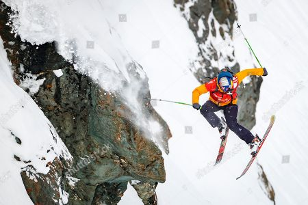 """Stock Picture of Markus Eder from Italy competes to win the third place of the Mens Skiing event during the Verbier Xtreme Freeride World Tour (FWT) finals on the """"Bec des Rosses"""" mountain above the alpine resort of Verbier, Switzerland, 02 April 2018."""