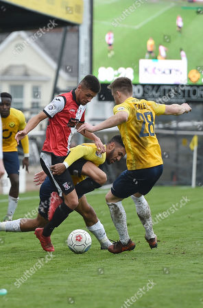 Kane Ferdinand of Woking battles for the ball with Jamie Reid of Torquay United, during the Vanarama National League match between Torquay United and Woking at Plainmoor, Torquay, Devon on April 2