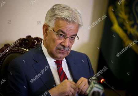 """Pakistan's Foreign Minister Khawaja Asif briefs journalists about a special cabinet meeting, at the Foreign Ministry in Islamabad, Pakistan, . At the cabinet meeting Prime Minister Shahid Khaqan Abbasi condemned the killing of """"innocent people in Kashmir by the Indian forces,"""" and asked the international community to urge India to allow fact-finding missions to be sent to Kashmir and asked the United Nations to appoint a special representative to Kashmir"""