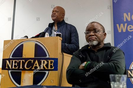 Stock Picture of South African Minister of Energy Jeff Radebe (L) speaks alongside National Chairperson of the African National Congress (ANC) Gwede Mantashe (R) at a press conference announcing the death of ANC Stalwart Winnie Mandela at Milpark Hospital, Johannesburg, 02 April 2018. Reports state former wife of South Africa's first black president, Nelson Mandela and veteran South African anti-apartheid activist Winnie Mandela passed away in a Johannesburg hospital on 02 April 2018 at age 81.