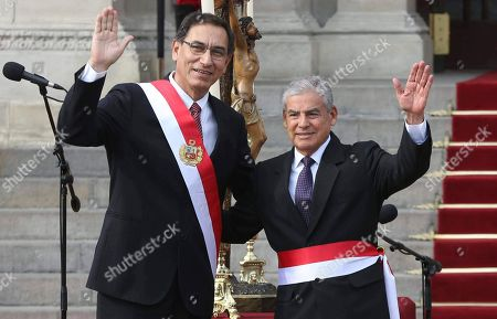 Martin Vizcarra, Cesar Villanueva. Peru's President Martin Vizcarra, left, waves alongside his Cabinet Chief Cesar Villanueva during a swearing-in ceremony of the new cabinet at the government palace in Lima, Peru, . Vizcarra was sworn-in to office in March, taking over from his predecessor Pedro Pablo Kuczynski who resigned over corruption allegations