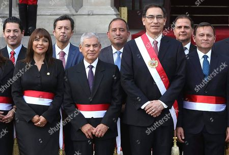 Martin Vizcarra, Cesar Villanueva, Nestor Popolizio, Francisco Ismodes, Daniel Cordova, David Tuesta, Liliana La Rosa, Salvador Heresi. Peru's President Martin Vizcarra, third from right, stands with some members of his new cabinet after their swearing-in ceremony at the government palace in Lima, Peru, . From right are Foreign Minister Nestor Popolizio, Energy Minister Francisco Ismodes, Vizcarra, Production Minister Daniel Cordova, Cabinet Chief Cesar Villanueva, Economy Minister David Tuesta, Development Minister Liliana La Rosa, and Justice Minister Salvador Heresi