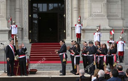 Martin Vizcarra, Cesar Villanueva. Peru's President Martin Vizcarra, left, waves alongside his Cabinet Chief Cesar Villanueva during the swearing-in ceremony of his new cabinet at the government palace in Lima, Peru, . Vizcarra was sworn-in to office in March, taking over from his predecessor Pedro Pablo Kuczynski who resigned over corruption allegations