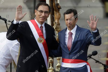 Martin Vizcarra, David Tuesta. Peru's President Martin Vizcarra, left, waves with his new Economy Minister David Tuesta during the swearing-in ceremony of the cabinet at the government palace in Lima, Peru, . Vizcarra was sworn-in to office in March, taking over from his predecessor Pedro Pablo Kuczynski who resigned over corruption allegations