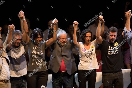 Brazil's former President Luiz Inacio Lula da Silva, center, stands with, from left, Brazilian singer Chico Buarque, Manuela D'Avila of the Communist Party of Brazil, Brazil's former President Luiz Inacio Lula da Silva, Monica Benicio, widow of slain councilwoman Marielle Franco and Rio's state Congressman Marcelo Freixo during da Silva's presidential campaign rally with members of his Workers Party and leaders of other left-wing parties in Rio de Janeiro, Brazil, . Despite a conviction on corruption charges that could see him barred from running, da Silva is the front runner in that race