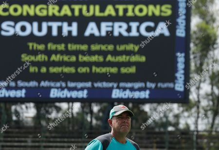Australia's coach Darren Lehmann watches on during the post match presentation on the fifth day of the final cricket Test match between South Africa and Australia at the Wanderers stadium in Johannesburg, South Africa, . South Africa sealed the series by crushing Australia by 492 runs in the fourth and final test on Tuesday