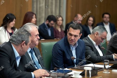 Alexis Tsipras, Yannis Dragasakis, Panos Kammenos. Greek Prime Minister Alexis Tsipras, centre, talks with Economy and Development Minister Yannis Dragasakis, second left, and Defense Minister Panos Kammenos during a cabinet meeting in Athens, Tuesday, April, 2018. Tsipras on Tuesday renewed a call on neighbor Turkey to release two Greek soldiers arrested on a border patrol last month