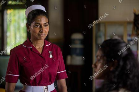 Stock Photo of Nimmi Harasgama as Nurse Mari Rodriguez