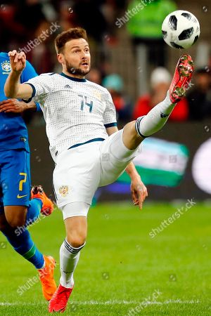 Russia's Vladimir Granat controls the ball during an international friendly soccer match between Russia and Brazil at the Luzhniki stadium in Moscow, Russia