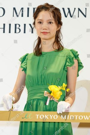 Japanese actress Aoi Miyazaki poses for the cameras during the opening ceremony for Tokyo Midtown Hibiya shopping mall