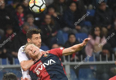 Genoa's Oscar Hiljemark (front) and Cagliari's Paolo Farago in action during the Italian Serie A soccer match Genoa CFC vs Cagliari Calcio at Luigi Ferraris stadium in Genoa, Italy, 03 April 2018.