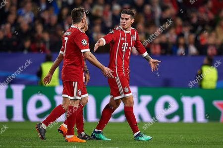 James Rodriguez of Bayern Munich congratulates Frank Ribery after the Thiago Alcantara goal.