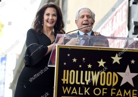 Stock Image of Leslie Moonves, Les Moonves. Leslie Moonves, chairman and CEO of the CBC Corporation, right, speaks during a ceremony honoring Lynda Carter, left, with a star on the Hollywood Walk of Fame, in Los Angeles