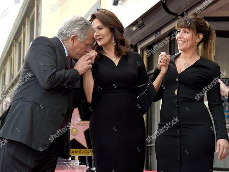 Leslie Moonves, Lynda Carter, Patty Jenkins. Leslie Moonves, chairman and CEO of the CBC Corporation, from left, kisses Lynda Carter's hand as director Patty Jenkins looks on following a ceremony honoring Carter with a star on the Hollywood Walk of Fame, in Los Angeles