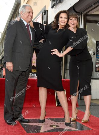 Leslie Moonves, Lynda Carter, Patty Jenkins. Leslie Moonves, chairman and CEO of the CBC Corporation, from left, Lynda Carter and director Patty Jenkins pose with Carter's star on the Hollywood Walk of Fame following a ceremony, in Los Angeles