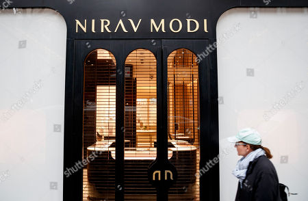 A woman walks past the closed Nirav Modi jewelry store on Madison Avenue in New York, New York, USA, 03 April 2018. Jeweler Nirav Modi, of India, has been accused by officials in India of illegally obtaining almost $3 billion (USD) from banks in India but has not been seen in public. A recent statement by his lawyer proclaimed his innocence and that the allegations were a misunderstanding over a loan of $40 million (USD).